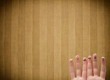 与葡萄酒条纹的愉快的手指面带笑容贴墙纸背景 免版税库存照片