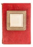 与葡萄酒照片框架的红色纺织品书套 免版税库存照片
