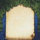 与葡萄酒羊皮纸的抽象Xmas背景 库存照片