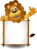 与董事会的狮子动画片 免版税库存照片