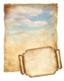 与蓝天和banner.jpg的老纸张当前被处理的 库存照片