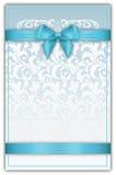 与蓝色丝带和弓的装饰花卉背景 免版税图库摄影