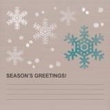 与蓝色和白色雪花的圣诞节节日问候卡片 免版税库存图片