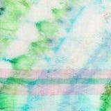 与蓝色样式和桃红色条纹的蜡染布 图库摄影