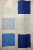 与蓝色正方形的背景 库存图片