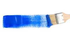 与蓝色油漆冲程的画笔 库存照片