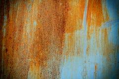 与蓝色油漆的纹理和背景老生锈的金属 免版税图库摄影