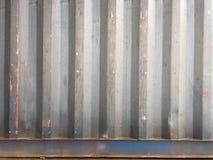 与蓝色油漆老层数的生锈的金属背景  纹理生锈了运输货柜 图库摄影