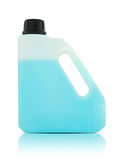 与蓝色液体的塑料加仑 免版税图库摄影