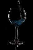 与蓝色液体的玻璃 免版税图库摄影
