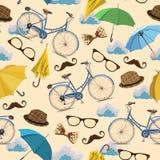 与蓝色葡萄酒的无缝的样式骑自行车,玻璃,伞,云彩,弓,帽子,在米黄背景的髭 库存图片