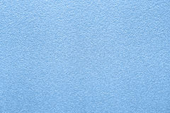 与蓝色银色表面效应的织地不很细纸背景 库存照片