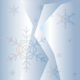 与蓝色雪花的冬天背景 免版税库存照片