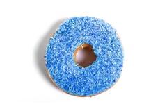 与蓝色顶部不健康的营养糖甜瘾概念的可口吸引的多福饼 免版税库存照片