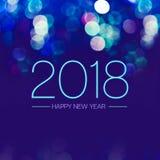 与蓝色bokeh轻闪耀的新年好2018年在深蓝 免版税库存照片