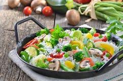 与蔬菜的米 库存照片