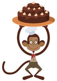 与蛋糕的猴子 免版税库存照片