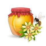 与蜂的蜂蜜瓶子 免版税库存照片