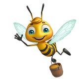 与蜂蜜罐的逗人喜爱的蜂漫画人物 免版税库存照片