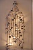 与蜡烛的花卉鸟笼 库存照片