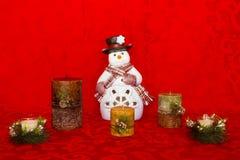 与蜡烛的雪人 库存照片