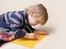 与蜡笔,艺术的儿童图画 图库摄影