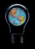与行星地球的电灯泡 库存图片