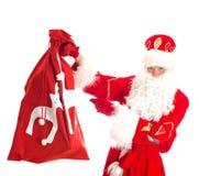 与袋子的圣诞老人存在 免版税库存图片
