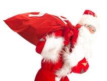 与袋子的圣诞老人存在 免版税库存照片