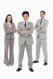 与被交叉的双臂的微笑的salesteam 免版税库存照片