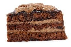 与被切的奶油的巧克力蛋糕 库存图片