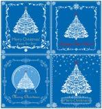 与被删去的纸白色xmas树、雪花、地球和花卉装饰bord的问候葡萄酒蓝色圣诞卡收藏 库存照片
