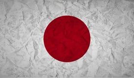 与被弄皱的纸和难看的东西的作用的日本旗子 库存照片