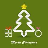 与被折叠的纸圣诞树的圣诞卡 库存图片