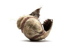 与被敲的盖子的棒球  库存照片
