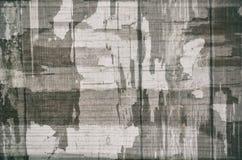 与被构造的老破裂的油漆,伪装的葡萄酒黑白灰色抽象背景 免版税库存照片
