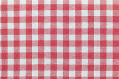 与被检查的桃红色方格花布样式的织品 免版税库存图片