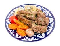 与被炖的菜混合的被烘烤的羊羔肉 免版税图库摄影