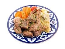 与被炖的菜混合的被烘烤的羊羔肉 图库摄影