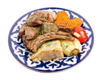 与被炖的菜混合的被烘烤的羊羔肉 免版税库存照片