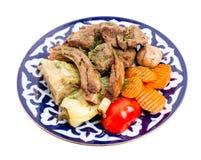 与被炖的菜混合的被烘烤的羊羔肉 库存图片
