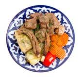 与被炖的菜混合的被烘烤的羊羔肉 库存照片