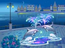 与被点燃的喷泉的美好的风景有海豚的 库存照片