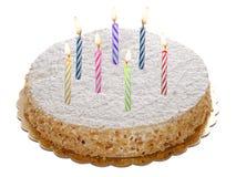 与被隔绝的被点燃的蜡烛的圆的整个蛋糕 库存照片