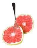 与被隔绝的匙子的新鲜,成熟,有机葡萄柚。 免版税库存图片