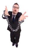 与被隔绝的链子的商人 免版税库存图片