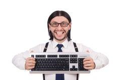 与被隔绝的键盘的年轻滑稽的商人 免版税库存照片