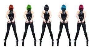 与被隔绝的头发的各种各样的颜色的性感的dominatrixes 免版税库存图片