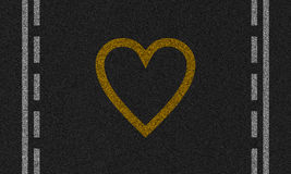 与被绘的心脏的沥青背景 库存图片