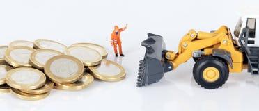 与装入程序的欧洲货币硬币 免版税库存图片